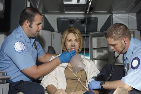 tubing: Paramedics taking care of victim in ambulance