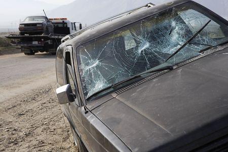 Car with broken windshield on roadside Stock Photo