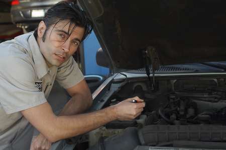 Mechanic pointing at engine, portrait Stock Photo - 3812447