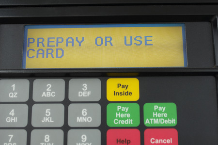 economic issues: Screen of gas pump with automatic payment, close-up LANG_EVOIMAGES