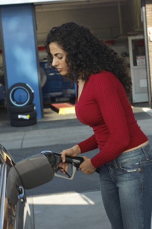 Woman pumping gas Stock Photo - 3812478