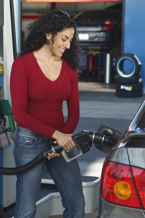 Woman pumping gas Stock Photo - 3812521