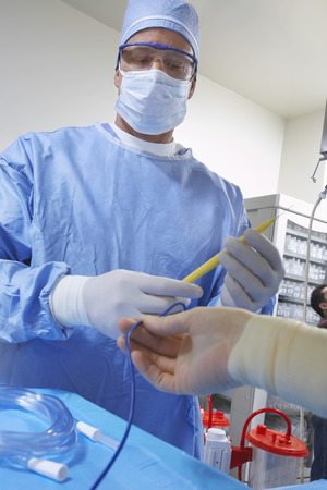 Surgeon in operating room, low angle view Banco de Imagens