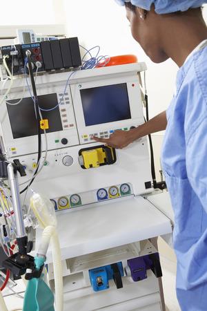 Female surgeon operating medical equipment Stock Photo - 3811170