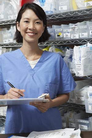 writing activity: Nurse standing by shelves with medical supplies, portrait