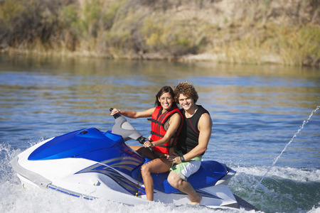 Young couple riding jetski on lake, portrait Stock Photo - 3812381