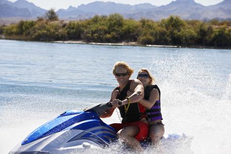 Young couple riding jetski on lake, portrait Stock Photo - 3812440