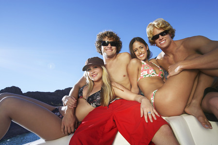 Two young couples relaxing on boat at lake, portrait Stock Photo - 3812258