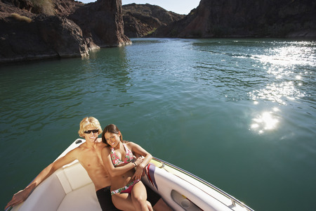 Young couple embracing in boat on lake, portrait Stock Photo - 3812489