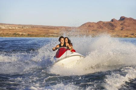 Young couple riding jetski on lake Stock Photo - 3812598