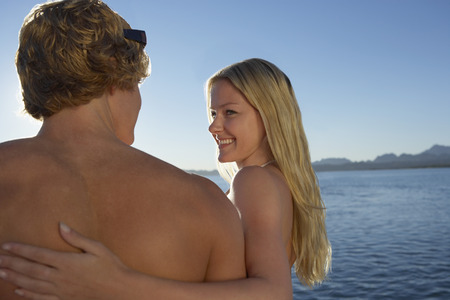 Young couple embracing at lake Stock Photo - 3811210