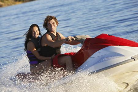 Young couple riding jetski on lake, portrait Stock Photo - 3812353