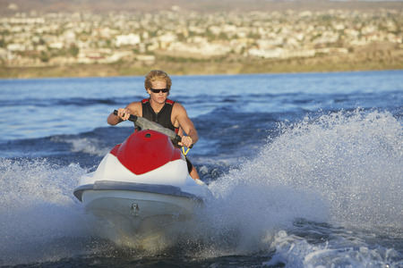Young man riding jetski on lake Stock Photo - 3812527