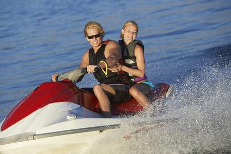 Young couple riding jetski on lake Stock Photo - 3811628