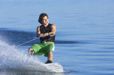 Young man wakeboarding on lake Stock Photo - 3812541