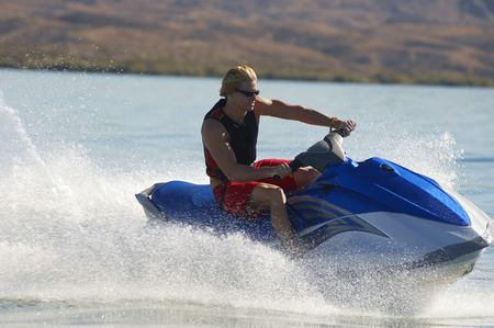 Young man riding jetski on lake Stock Photo - 3812601