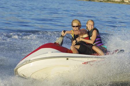 Young couple riding jetski on lake Stock Photo - 3812549