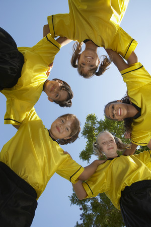 Five children soccer players (7-9 years) huddling, view from below, portrait Stock Photo - 3812559