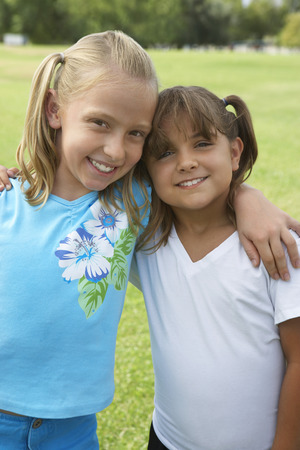 two girls hugging: Two girls (7-9 years) hugging, portrait LANG_EVOIMAGES
