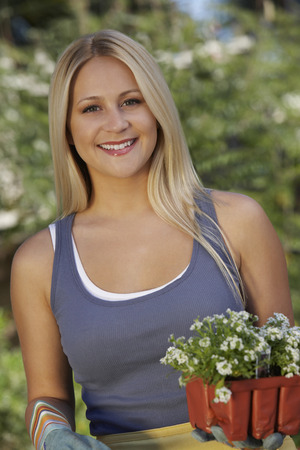 Portrait of woman with flowers in garden Stock Photo - 3812338
