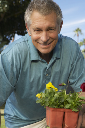 Portrait of man with flowers in garden Stock Photo - 3812501