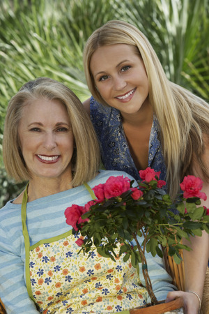 Portrait of two women with flowers in garden Stock Photo - 3812553
