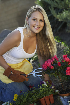 Woman gardening, smiling, portrait Stock Photo - 3812256