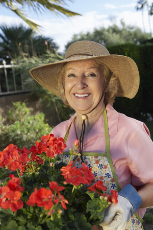 Portrait of senior woman with flowers in garden Stock Photo - 3812551