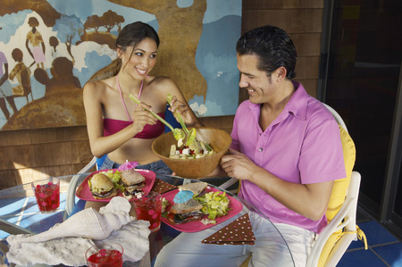 Couple eating meal at outdoor table Stock Photo - 3812617