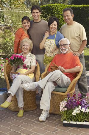70s adult: Portrait of family in garden