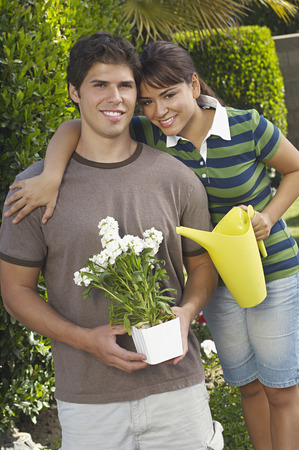 Portrait of couple in garden with gardening tools Stock Photo - 3812653