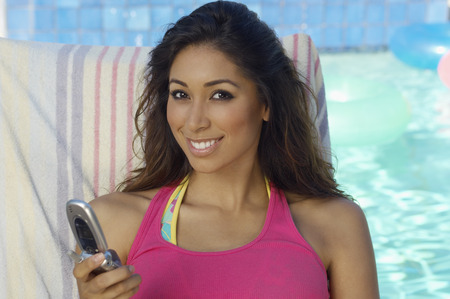 Portrait of woman with mobile phone at swimming pool Stock Photo - 3812402