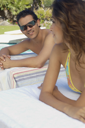 Couple relaxing on deck chairs Stock Photo - 3811239