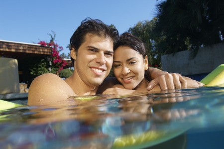 Portrait of young couple in swimming pool Stock Photo - 3812548