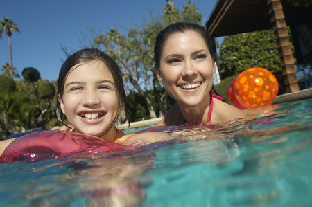 Mother and daughter smiling in swimming pool, portrait Stock Photo - 3812605