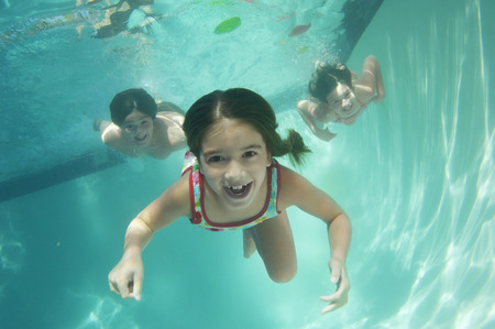 Children swimming, underwater view LANG_EVOIMAGES