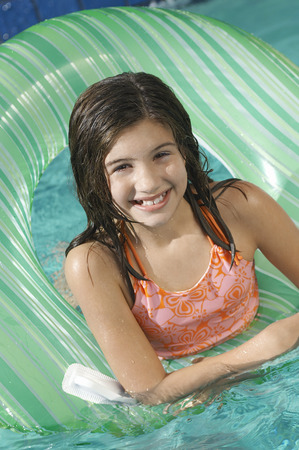 Girl in inflatable raft in swimming pool, portrait Stock Photo - 3812591