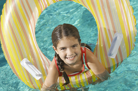 Girl in inflatable raft in swimming pool, portrait Stock Photo - 3812608