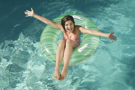 Girl in inflatable raft in swimming pool, portrait Stock Photo - 3812690