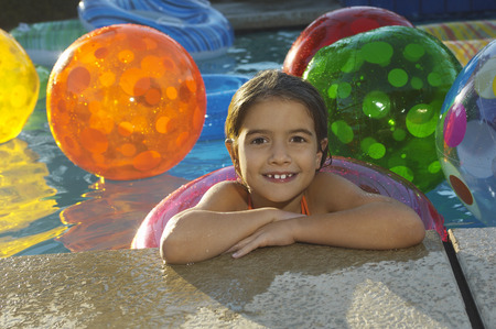 Girl in swimming pool with assortment of beach balls, portrait Stock Photo - 3812656