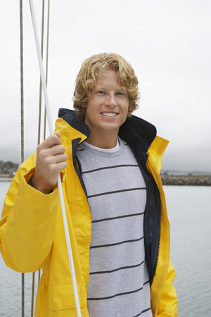 Young man standing on yacht, portrait Stock Photo - 3811199