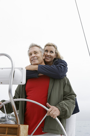 Couple at helm of sailboat, smiling Stock Photo - 3811109