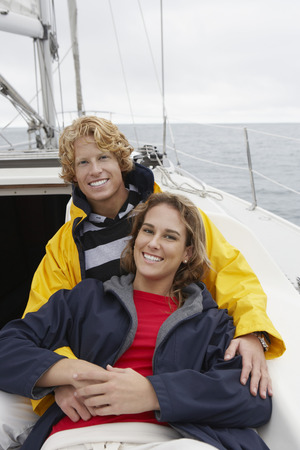 Young couple smiling on sailboat, portrait Stock Photo - 3811147