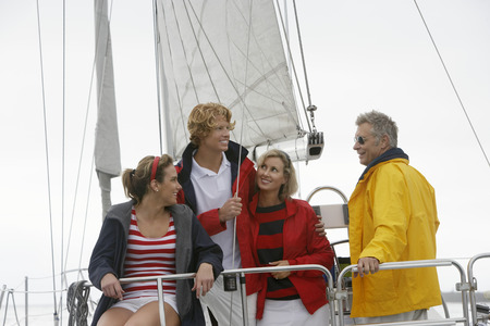Four people on sailboat in sea Stock Photo - 3811150