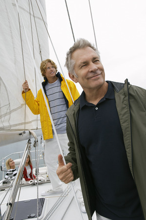 Father and adult son on yacht Stock Photo - 3812259