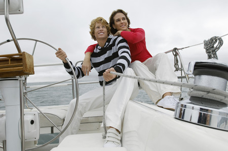 Young couple smiling on sailboat Stock Photo - 3812214
