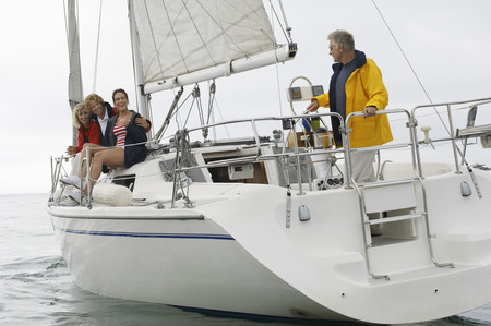 Four people on sailboat in sea Stock Photo - 3812229