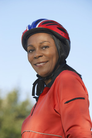 Senior woman wearing cycling helmet, outdoors, portrait Stock Photo - 3811220
