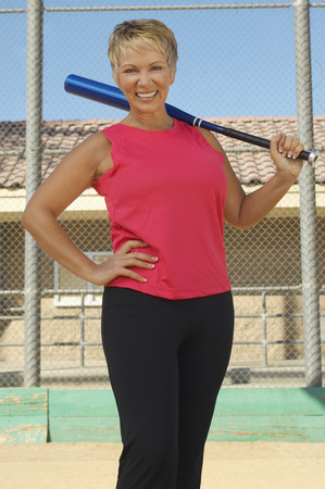 Senior woman with baseball bat outdoors, portrait Stock Photo - 3812401