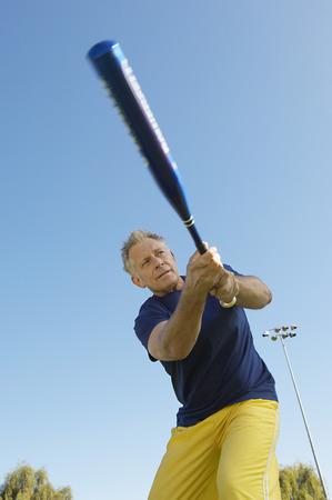 Senior man swinging baseball bat Stock Photo - 3812263